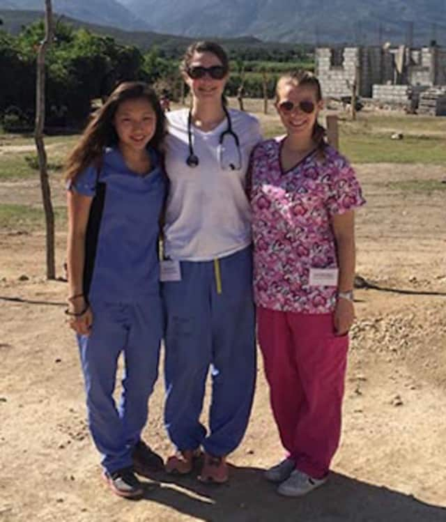 From left, William Paterson nursing students Grace Gil and Lynda Amici, and volunteer Amanda Lynne