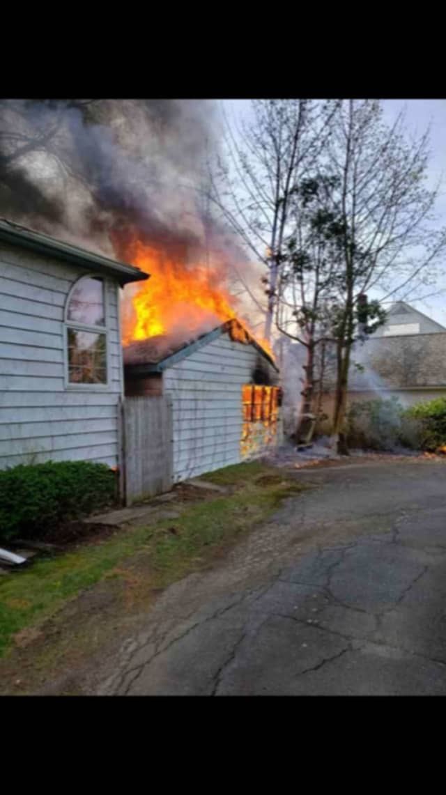 A home and detached garage were heavily damaged during a fire.