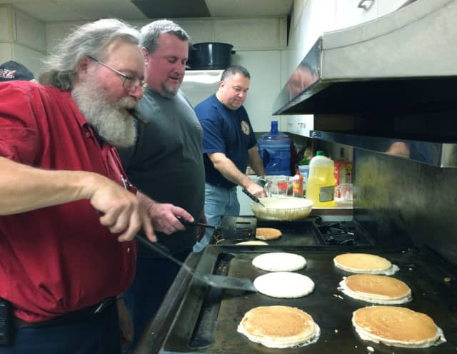 From left, Pound Ridge volunteer Firefighters David Andronaco, Larry Bouton and Terry McNamara work in the kitchen for the Fire Department's first annual pancake breakfast.