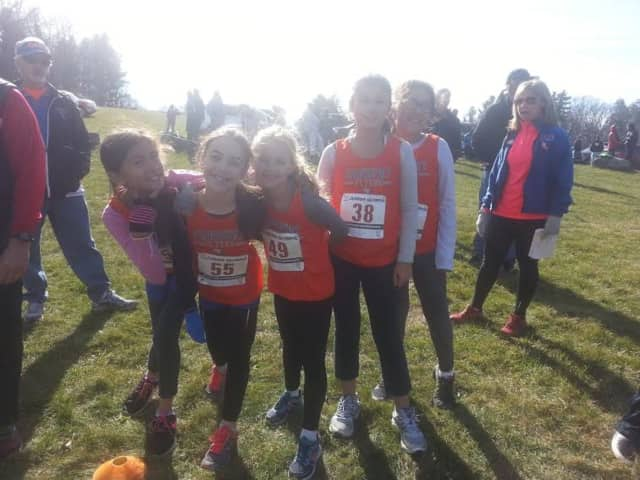 Girls on the Danbury Flyers ran Sunday at the district championship meet in Litchfield.