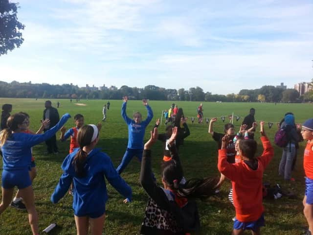 The Danbury Flyers cross country team warms up before the race.