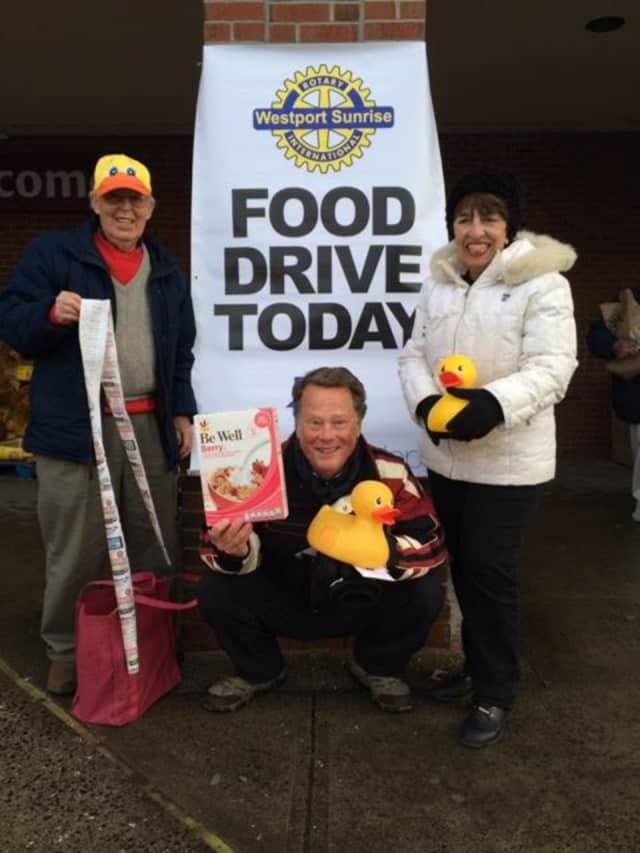 From left: Tom Lowrie, Joe Hawley, and June Getrayer hold a food drive at Stop & Shop with the Westport Sunrise Rotary to refill the shelves at the food pantry at the Gillespie Center in Westport.