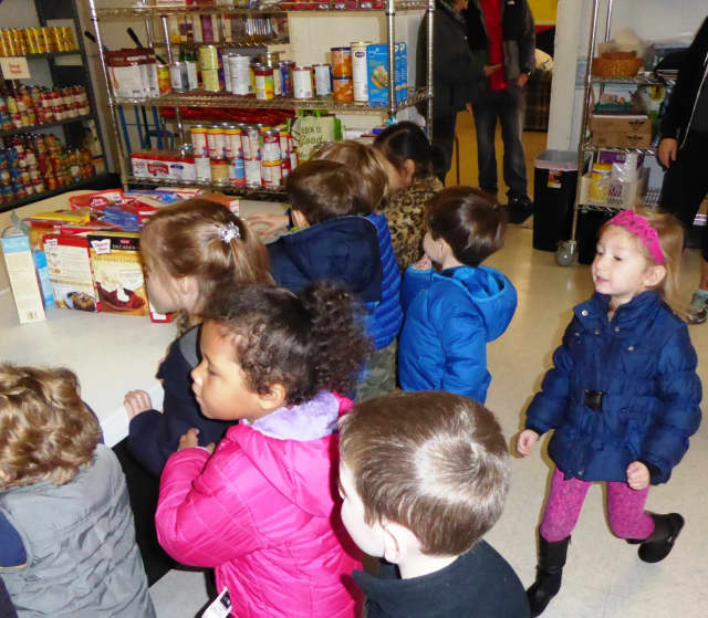 Children from the Jewish Community Center on the Hudson's Early Childhood Program in Tarrytown assembled goodie bags for the community food pantry.