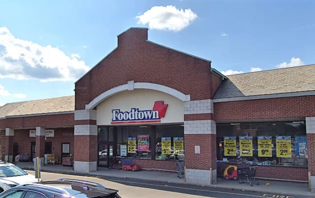 The victim was walking behind the vehicle when it pulled out of a parking space at the Foodtown in the Bi-State shopping center Sunday afternoon, police said.