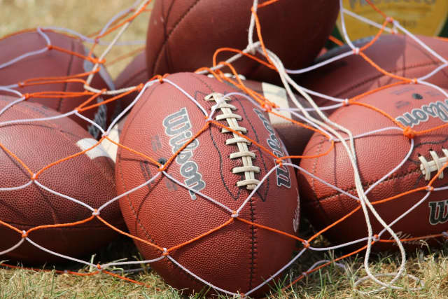 The footballs will stay in the bag for Connecticut high schools due to COVID-19.