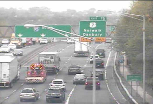 A truck is blocking the center lane of I-95 in Norwalk.