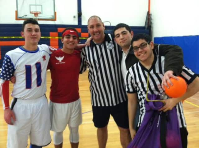 Phys ed teacher and Fun Ball creator Bobby Herodes, center, stands with students at Horace Greeley High School after last year's tournament.