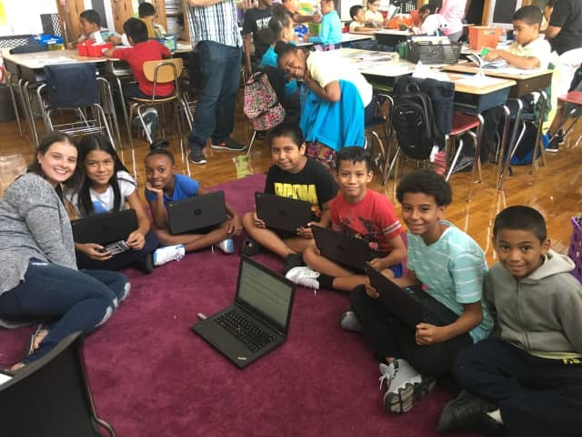 Students at PS 9 Ryer Avenue Elementary School, Bronx, N.Y,  use their Chromebooks. Their teacher Rosemary Garabito of Garnerville started a fundraiser to buy the laptops for students there.