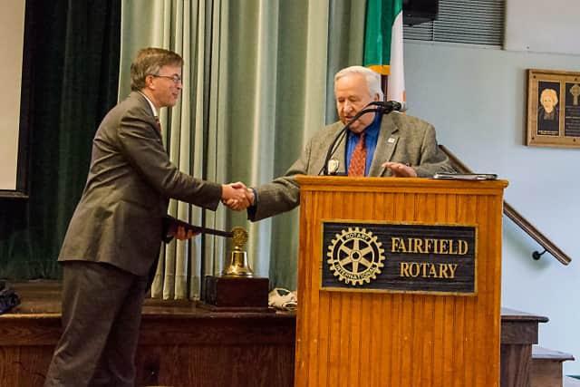 "Longtime Rotarian John ""Mac"" Leask, right, presents the Paul Harris Fellowship to Fairfield Community and Economic Development Director Mark Barnhart, left."