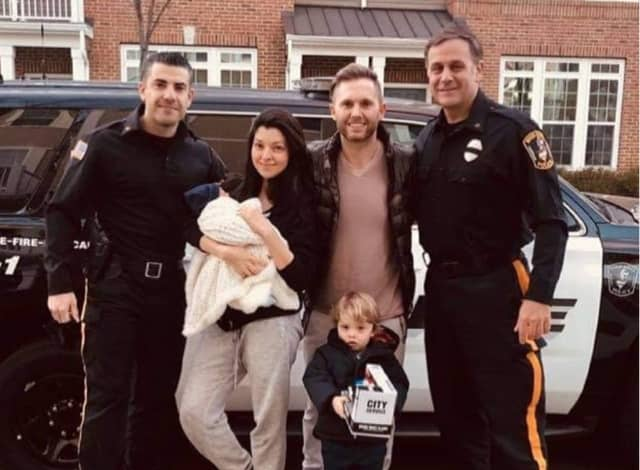 Officers Roberto Cangialosi and Michael Mueller and the Jackson family.