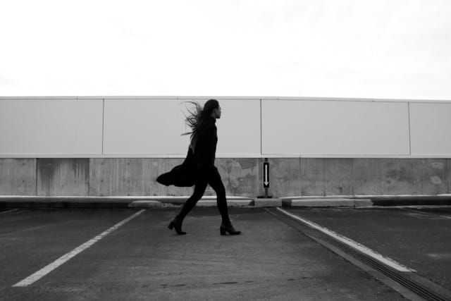 Woman walking on a windy day