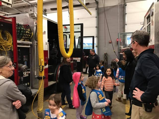 Children in Daisy Girl Scout Troop 50261 ask questions of the firefighters on a recent trip to the Stony Hill Fire Department.