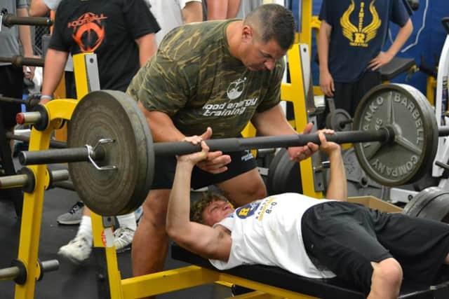 Ramsey Rams football player Tye Baruffaldi lifts heavy weights with GE Trainer Pete Ohnegian