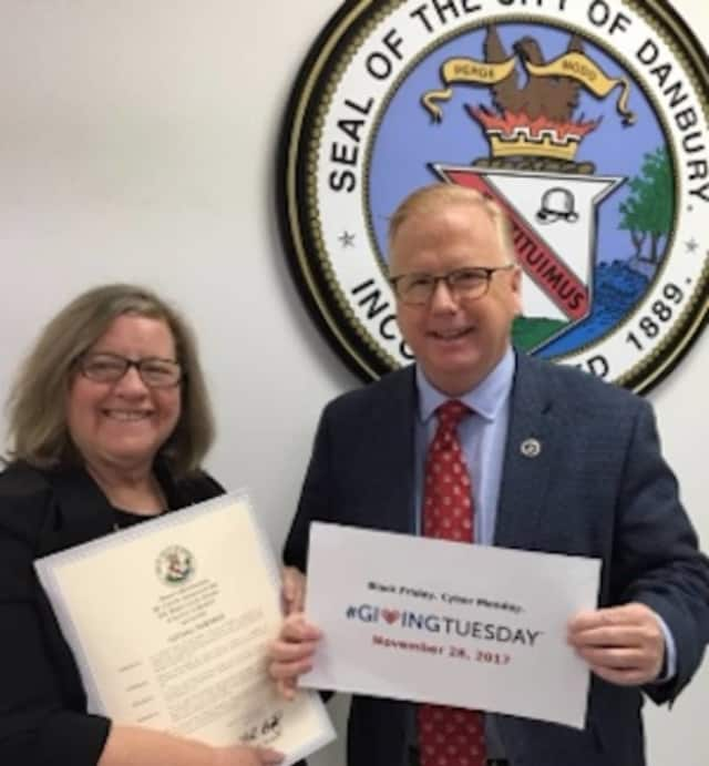 Danbury Mayor Mark Boughton with Housatonic Habitat for Humanity Executive Director Fran Normann who receives the City's Proclamation declaring Tuesday, Nov. 28 as #GivingTuesday in greater Danbury.