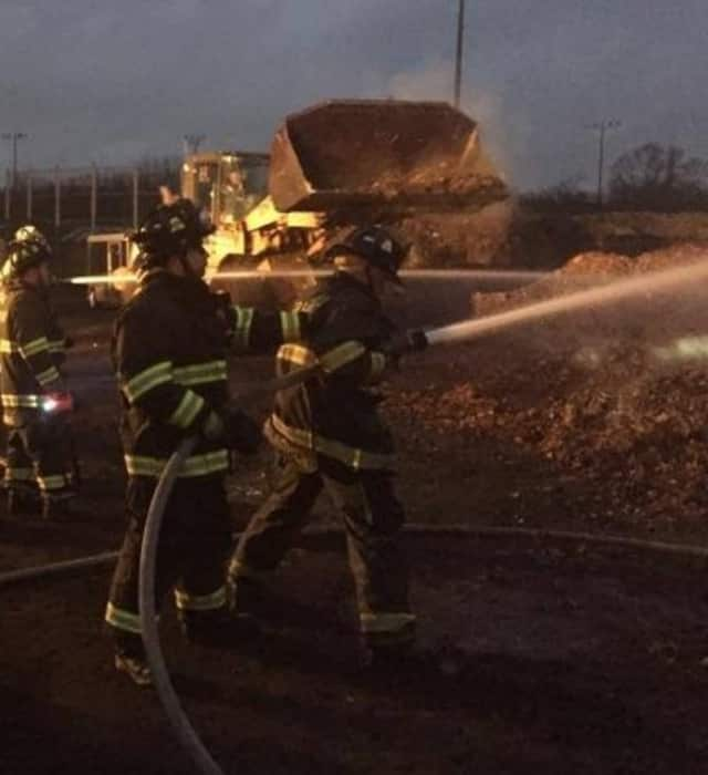 Glen Rock firefighters douse leaf-pile fire.