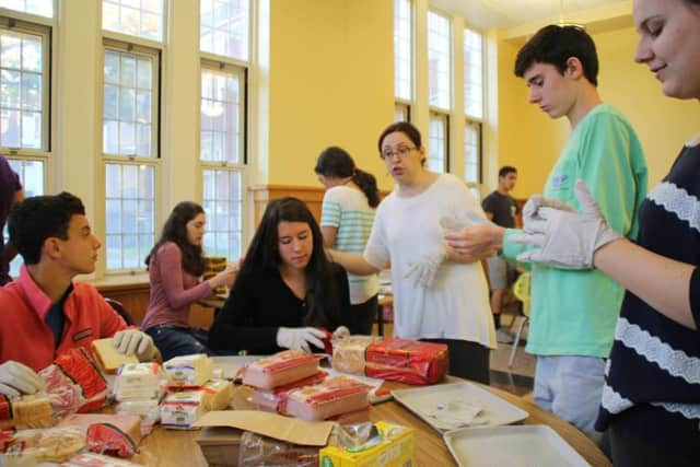 Students packed meals for the Food for Hope Soup Kitchen.