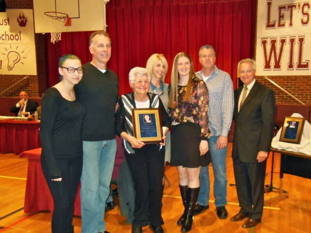 Grace McGee with her family and East Rutherford Board of Education members at the recent East Rutherford Board of Education meeting at which she was honored.