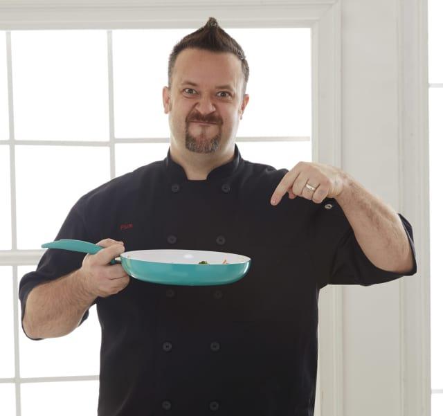 Chef Plum joking around in the kitchen.