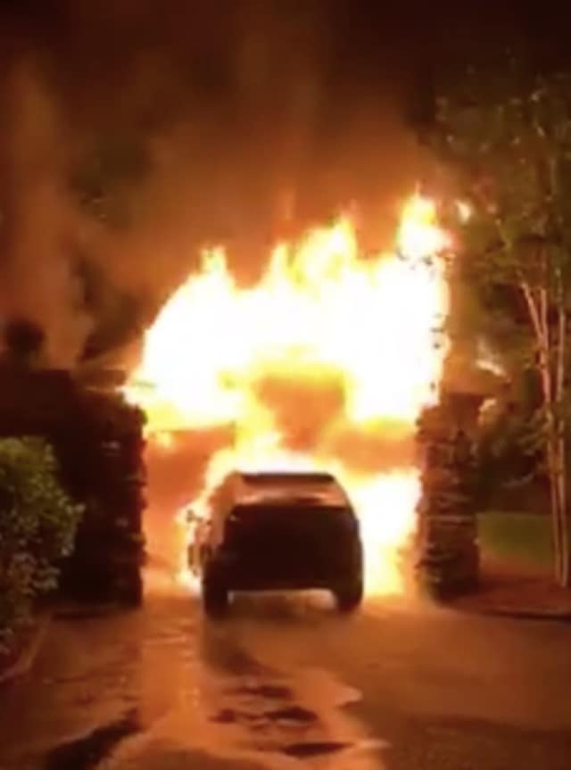 Screenshot of a video depicting a garage on Hillcrest Park Road in Greenwich going up in flames