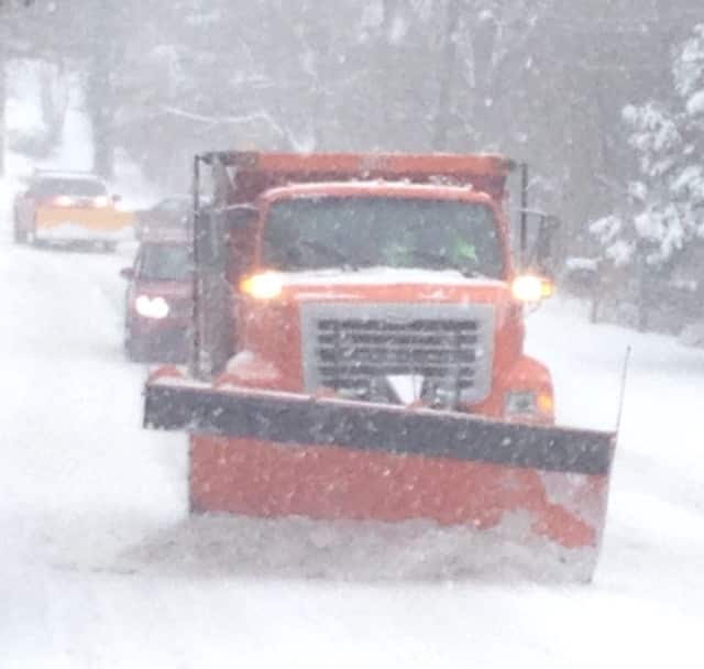 Snow plows from the Greenwich Department of Public Works hit the roads on Saturday as more than a foot of snow piled up.