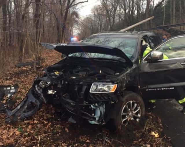 """A driver in Greenwich crashed his SUV into a utility pole after he told police he """"zoned out"""" while driving."""