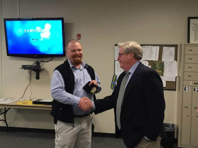 Greenwich Police Officer Jeremy Bussell has completed his investigative probation and has been promoted to detective. His badge was presented by his father, Detective Lieutenant Ronald Bussell, a veteran of the Darian Police Department.