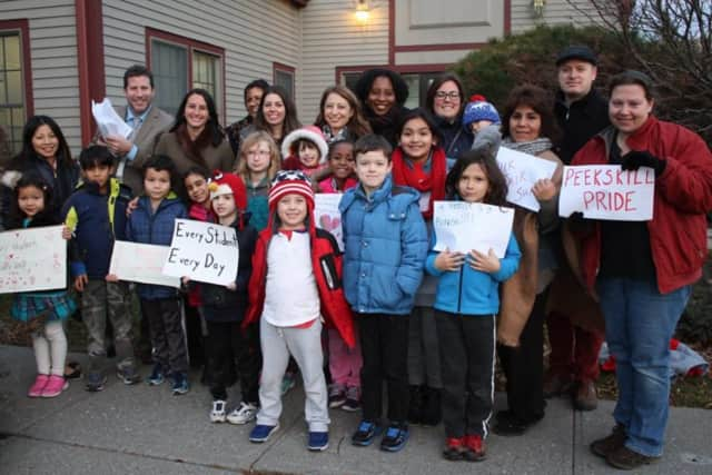 Peekskill students, parents and educators hand-delivered letters to Sen. Terrence Murphy's Shrub Oak office asking that the state unfreeze aid and revamp the current formula for its distribution.