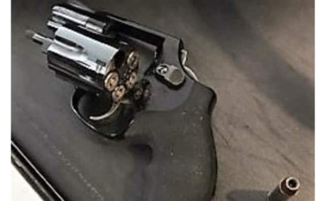 Gun, bullets found in Newark Airport carry-on bag.