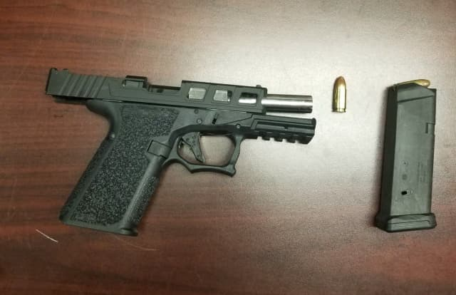 The gun allegedly found during the traffic stop.