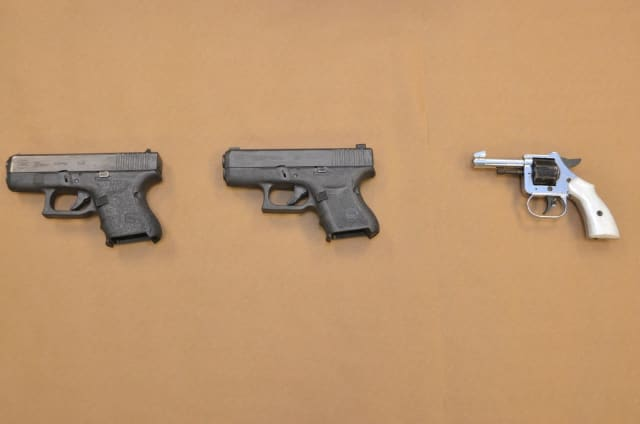The guns seized during the arrest.