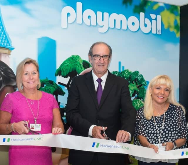 "Colleen Kearney of the Joseph M. Sanzari Children's Hospital, left; Mark Cohen of Playmobil USA; and Rosemarie ""Ro"" Sorce of the HackensackUMC Board of Governors."