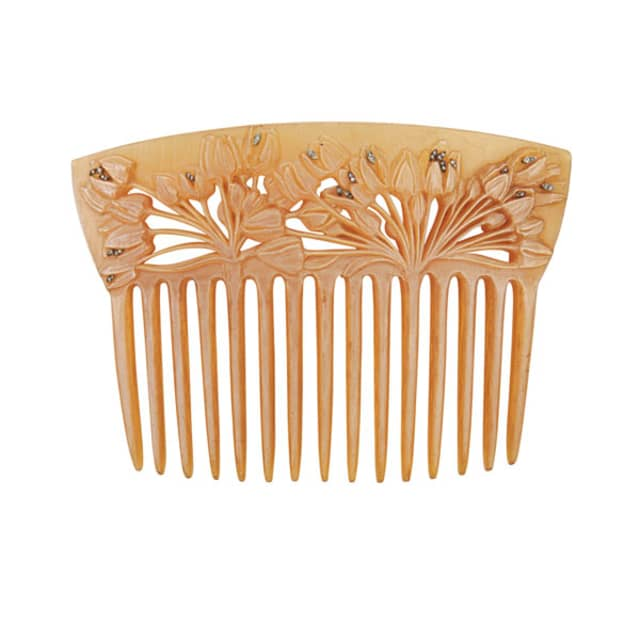 René Lalique was as acclaimed for his accessories as for his home designs, as this horn and diamond hair comb (circa 1900) attests. It sold for $33,750 at Rago. Images courtesy Rago Arts and Auction.