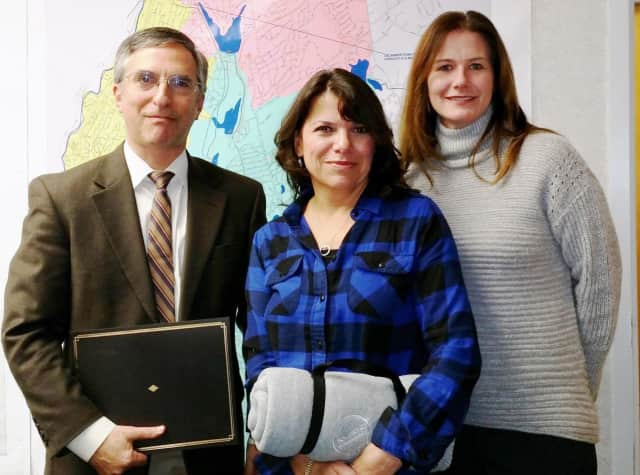 Bruce Reidenberg, M.D., of Rye, left, and Camille Taglia, of Eastchester, center, were recognized for their service by Lynda DiMenna, manager of SUEZ operations in Westchester County.