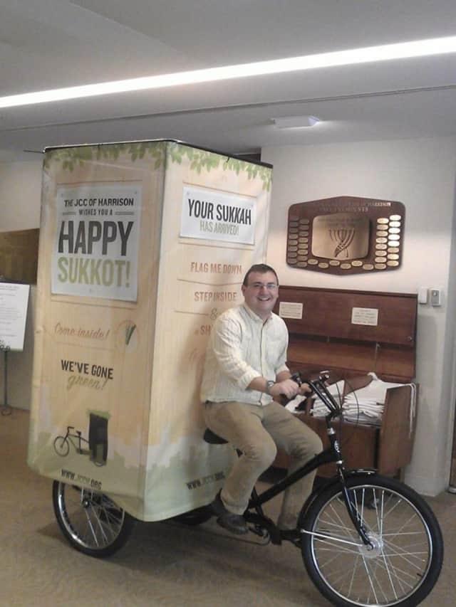Rabbi Eytan Hammerman on his Sukkah bicycle.
