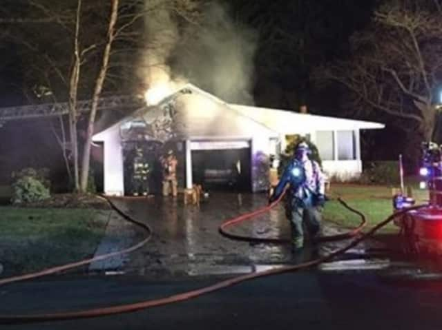 The fire began in a sedan in the garage.
