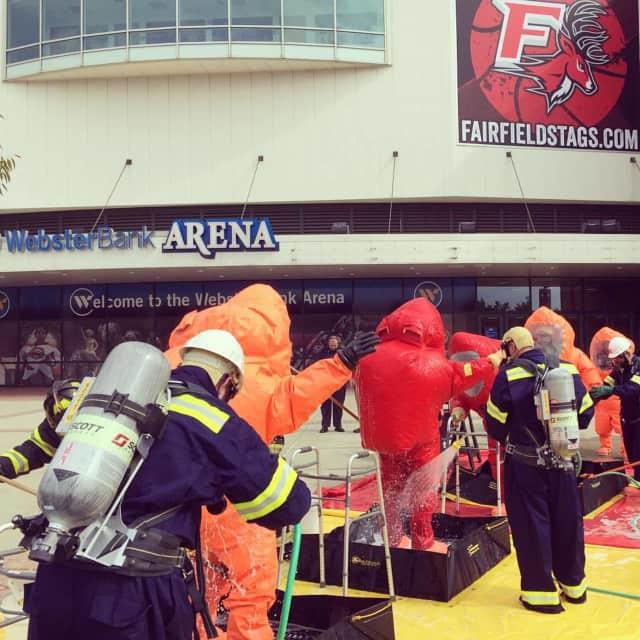 Members of the Fairfield County Hazardous Incident Response Team complete a Hazmat drill Monday at Bridgeport's Webster Bank Arena.