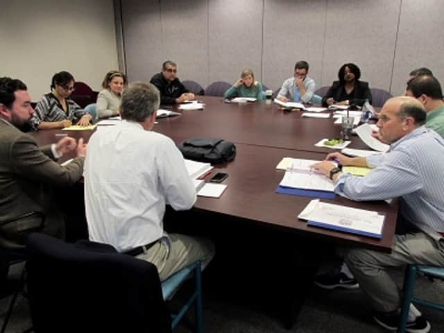 Members of the New Rochelle High School's Health and Safety Committee go over a report on the facility recently. The Board of Education meets Tuesday, March 29, on four capital bond options.