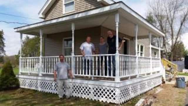 Members of the Newtown Police Department assisted in refurbishing the home of a disabled veteran.