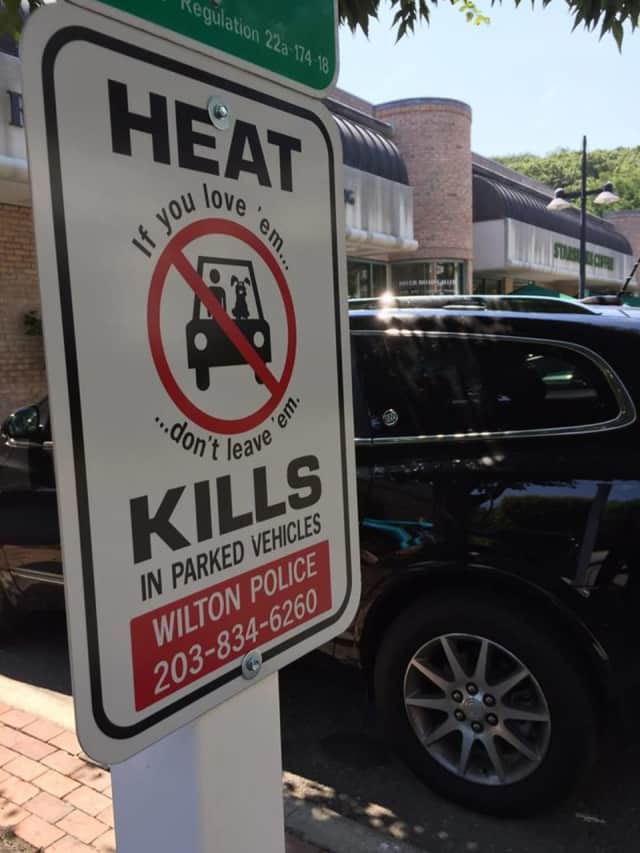A sign initiative has been started in Wilton to discourage people from leaving children and pets in hot cars.