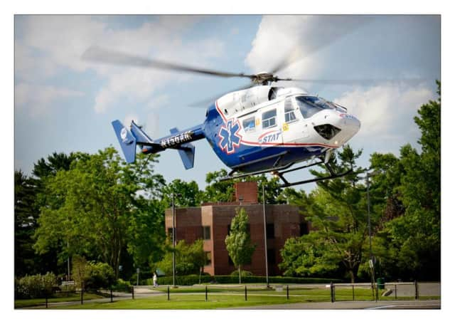 Two workers from Oprandy's Fire Equipment were helicoptered to Westchester Medical Center Friday morning after their legs were severely injured in an explosion.