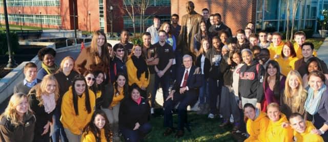 Henry Rowan with students from Rowan University.