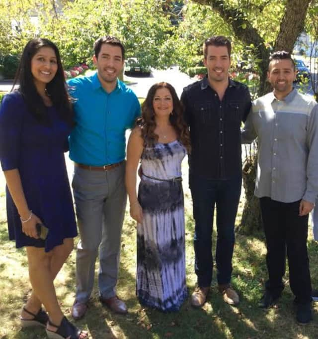 Jonathan and Drew Scott of HGTV's popular Property Brothers show meet the owners of a renovated home in Rye Brook.