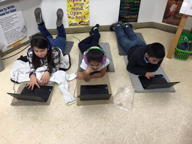 Students at Hillcrest Elementary School learn coding at an Hour of Code event.