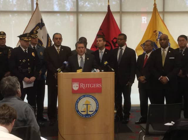 Acting NJ Attorney General John Hoffman joined by police chiefs, civic leaders.