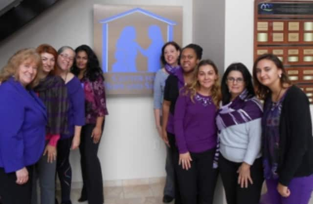 From left, Executive Director Elaine Meyerson with her staff dressed in purple during last year's Domestic Violence Awareness Month events.