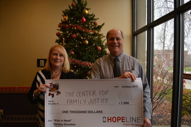 Verizon helps The Center for Family Justice in Bridgeport this holiday season with a $1,000 grant.