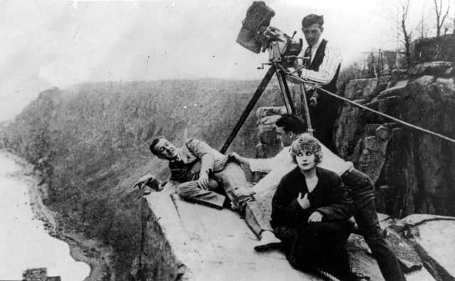 "Pearl White, during filming ""The House of Hate"" at Cliffhanger Point on the Palisades, in 1918."
