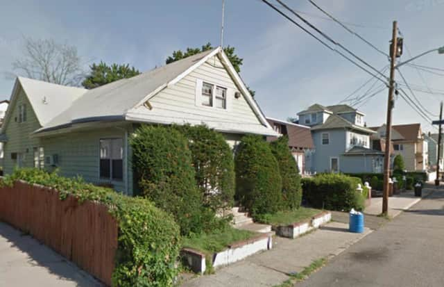 Rui Zhou was gunned down in front of this house on East 34th Street in Paterson.