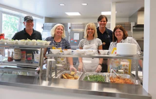 """A team of volunteers from Hudson Peak Wealth Advisors in Pleasantville participate in a """"Day of Service"""" at the Open Arms Men's Shelter in White Plains. From left are Eric Nachman, Pam Wetherbee, Patricia Hughes, Darrel Upson and Ann Herrero."""