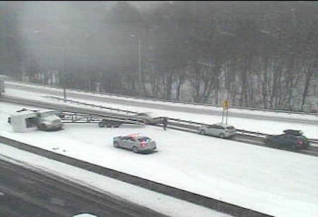 A jack-knifed tractor-trailer blocks most of I-95 northbound in Milford near Exit 35.